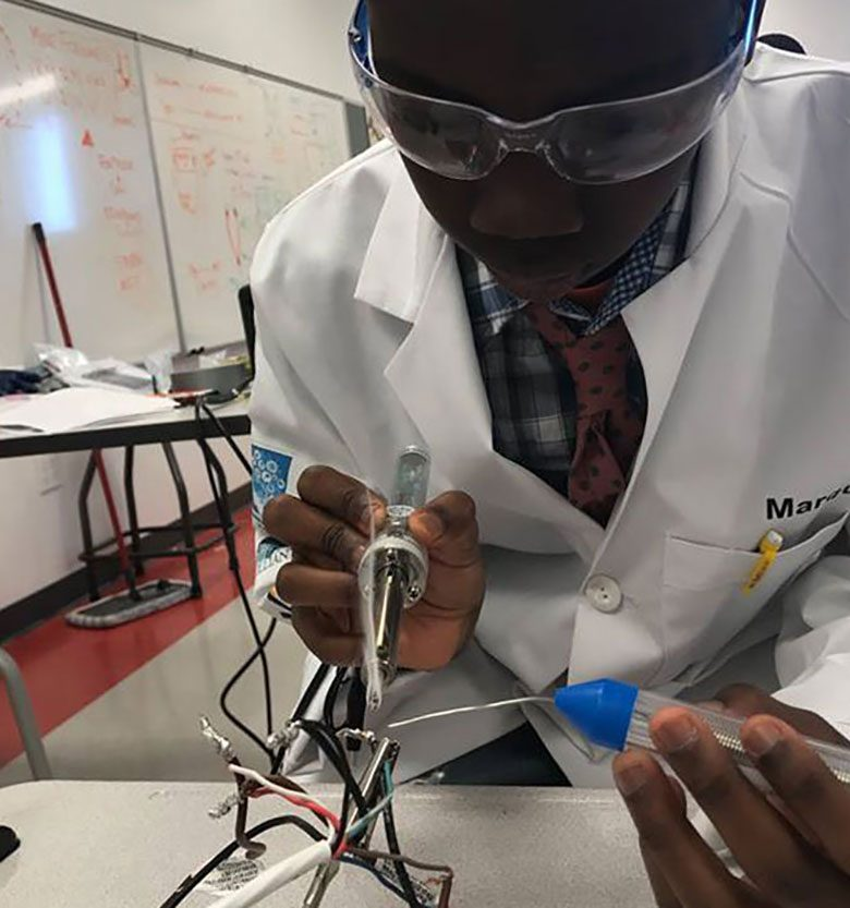 Boy Working with a Soldering Kit